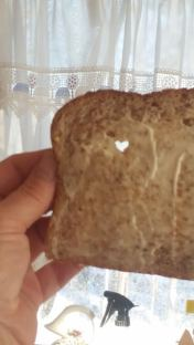 Heart shape hole in slice of bread (2)